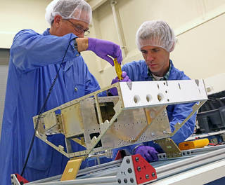 Engineers begin construction of the first of eight microsatellites for NASA's Cyclone Global Navigation Satellite System at the Southwest Research Institute in San Antonio, Texas. Communication antennas, attitude control, GPS receiver, and other instrumentation will be installed on the satellite frame in the coming weeks. Credits: SwRI